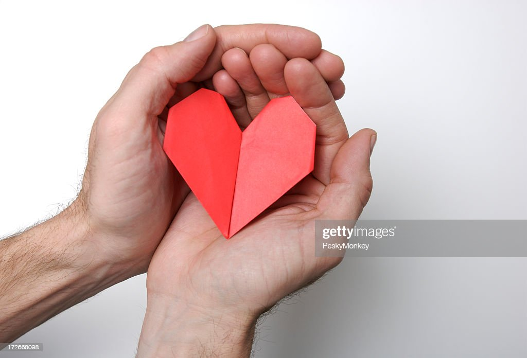 Hands Holding Folded Origami Heart White Background : Stock Photo