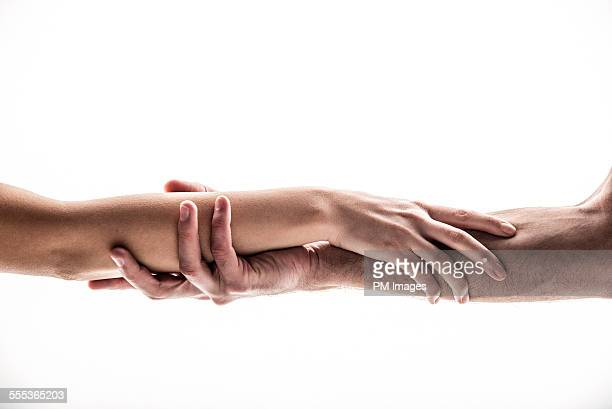 Hands holding forearms