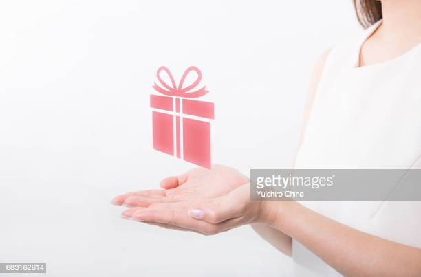 Hands holding gift