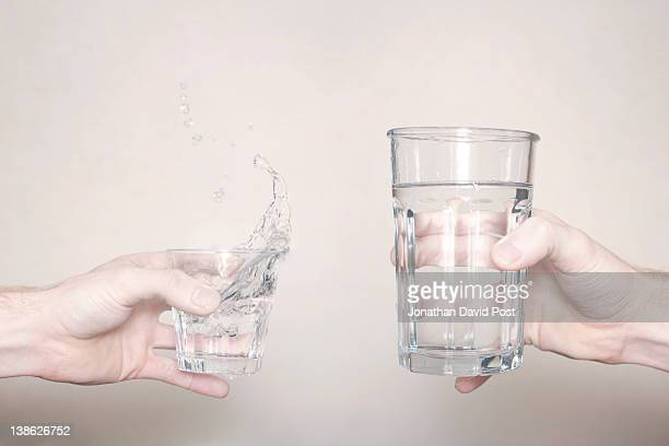 Hands holding glass of water