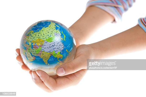 hands holding globe - plusphoto stock pictures, royalty-free photos & images