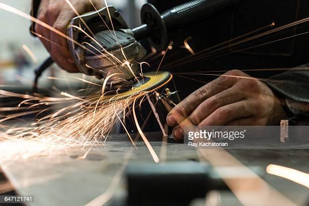 Hands holding grinder
