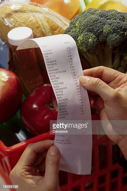 Hands holding grocery receipt
