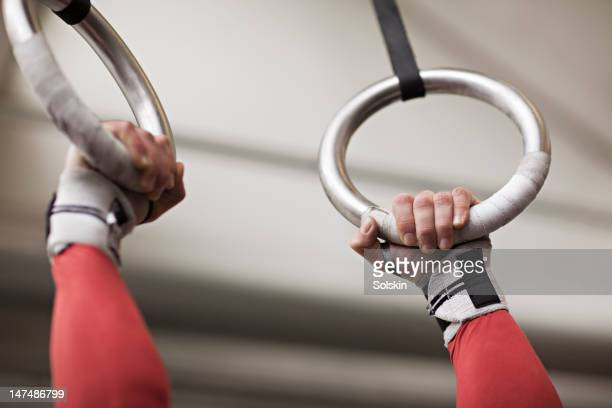 Hands holding gymnastics rings