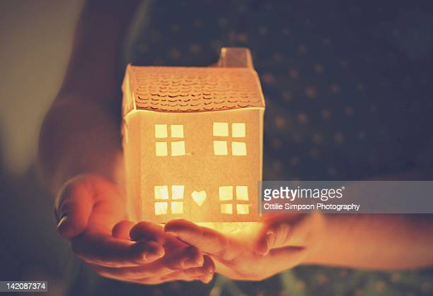 Hands holding house
