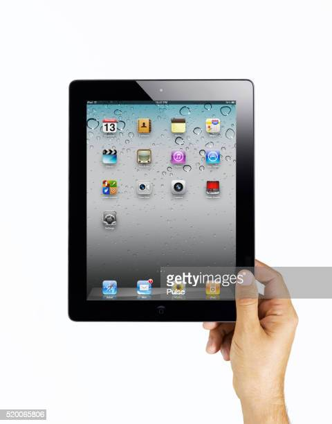 Hands holding iPad 2