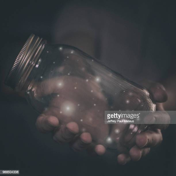 hands holding jar with fireflies - fireflies stock pictures, royalty-free photos & images
