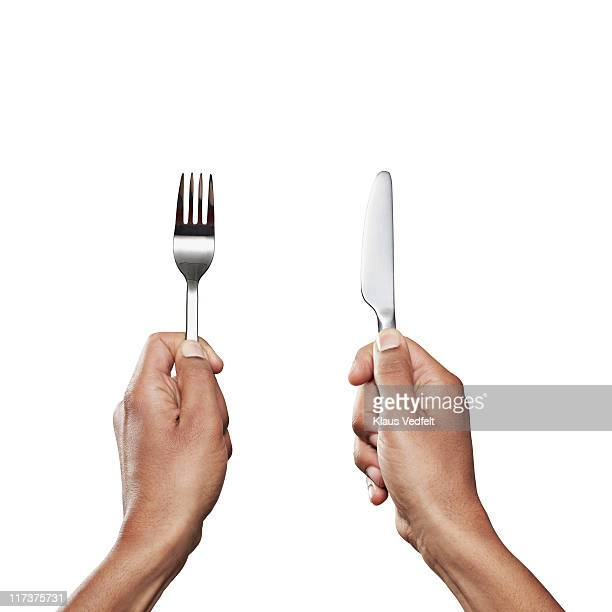hands holding knife and fork close-up - forchetta foto e immagini stock