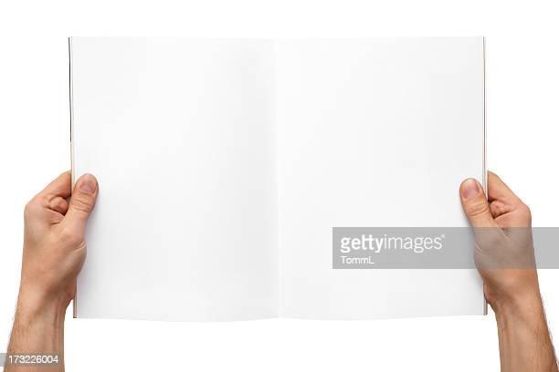 Hände holding magazine