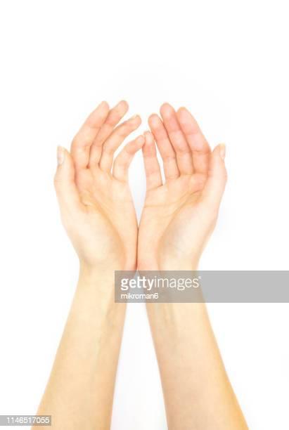 hands holding out palm straight - armoede stock-fotos und bilder