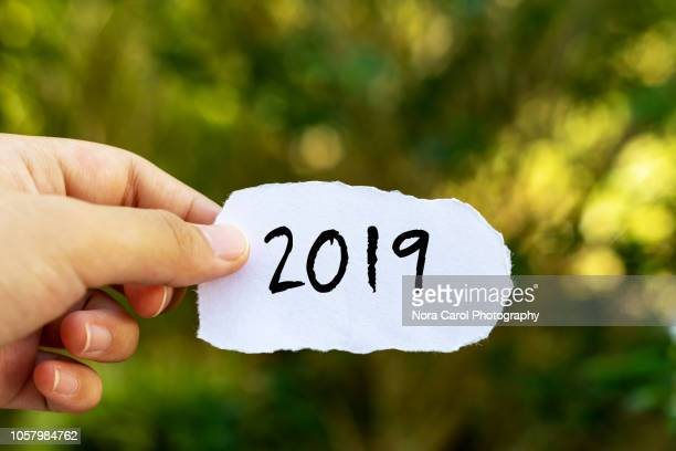 hands holding paper with number 2019 - 2019 stock pictures, royalty-free photos & images