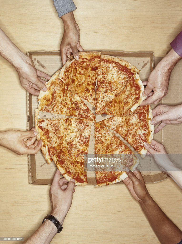 Hands Holding Pizza Slices : Stock Photo