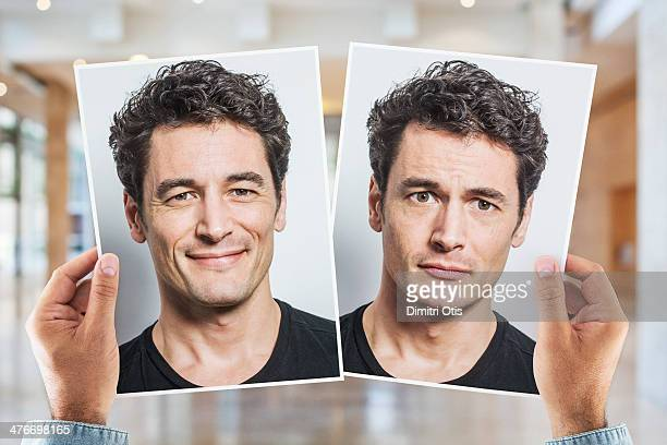 Hands holding portrait of man being happy and sad