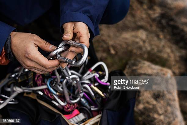 hands holding rock climbing gear - climbing equipment stock pictures, royalty-free photos & images
