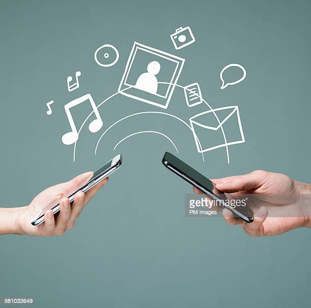 Hands holding smart phones