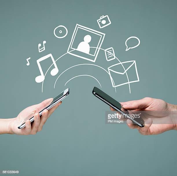 Hands holding smart phones