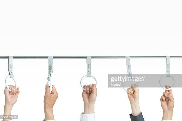 Hands holding strap on bar