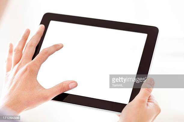 Hands Holding Tablet PC with Blank Screen