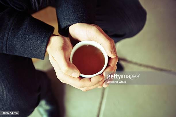 Hands holding tea