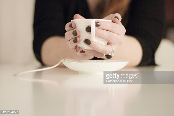 hands holding teacup - catherine macbride 個照片及圖片檔