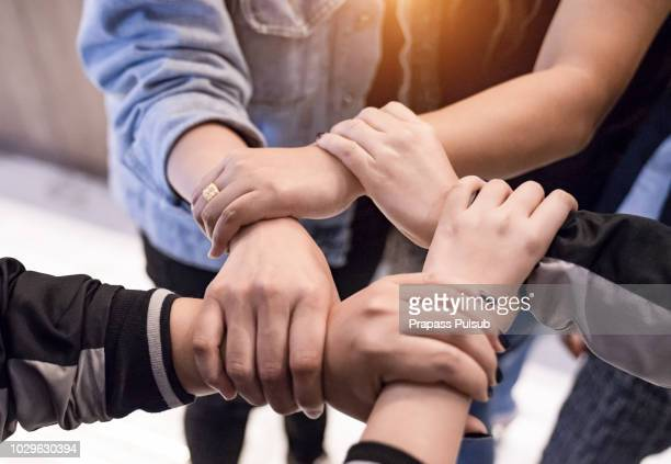 hands holding teamwork cooperation togetherness concept - dedizione foto e immagini stock
