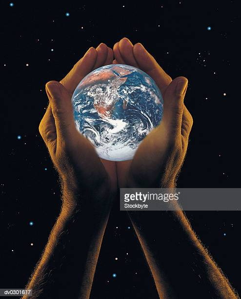 hands holding the earth, starry background - world at your fingertips stock pictures, royalty-free photos & images