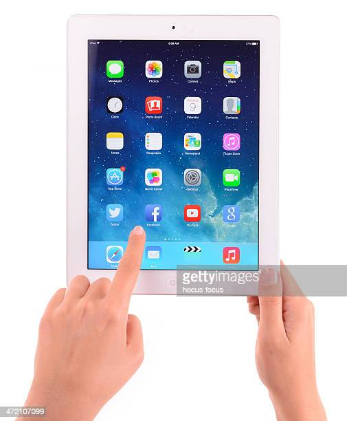 Hands holding The New iPad on white background