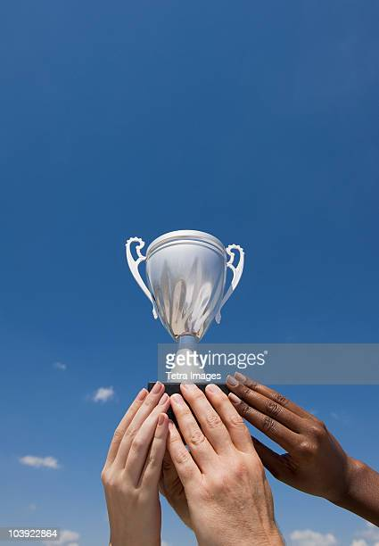 Hands holding trophy in the air