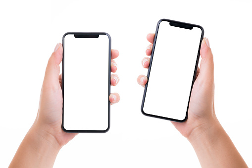 Hands holding two blank white screen smart phones 1161923273