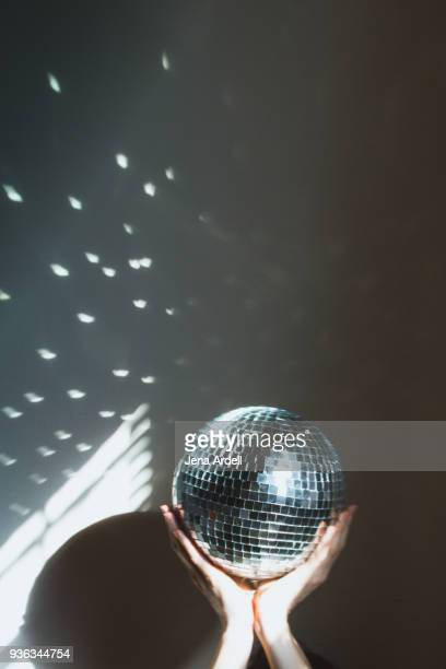 Hands Holding Up Disco Ball