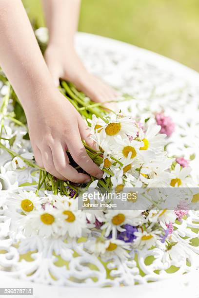 Hands holding wildflowers