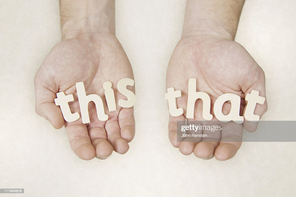 hands holding wooden letters spelling words : Stock Photo