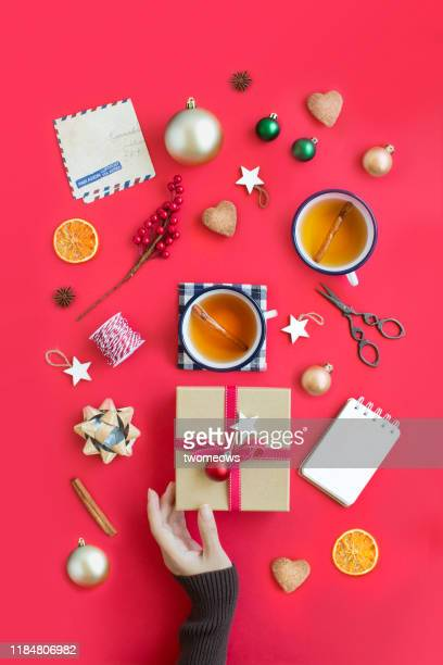 hands holding wrapped gift box. - art and craft stock pictures, royalty-free photos & images