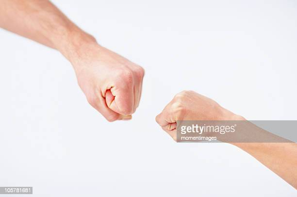 hands in a fist - fist stock pictures, royalty-free photos & images