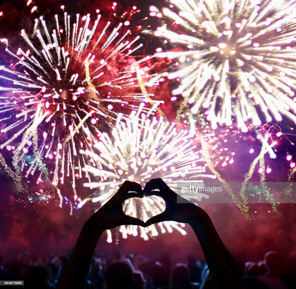 Hands in a heart shape at firework display : Stock Photo