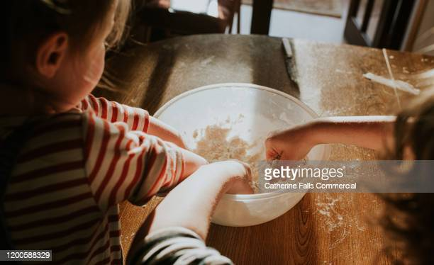 hands in a mixing bowl - baking bread stock pictures, royalty-free photos & images