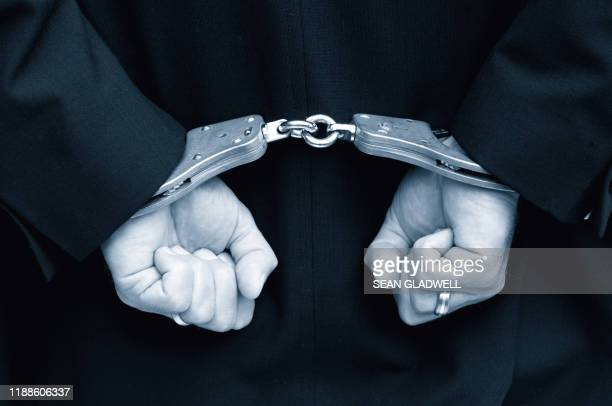 hands in handcuffs - police force stock pictures, royalty-free photos & images