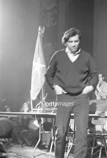 Hands in his pockets Germanborn American concert promotor Bill Graham walks off the stage at the Filmore East during the venue's takeover by...