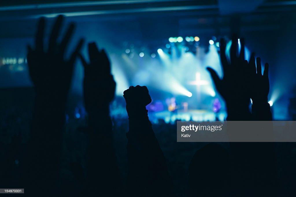 As mãos em um culto : Foto de stock