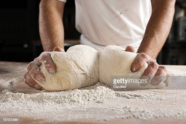 hands kneading dough - dough stock pictures, royalty-free photos & images