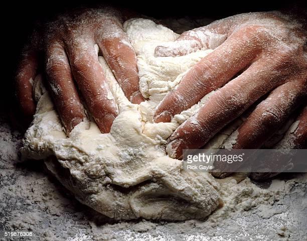 Hands kneading dough