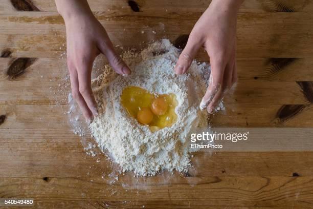 Hands kneading homemade dough