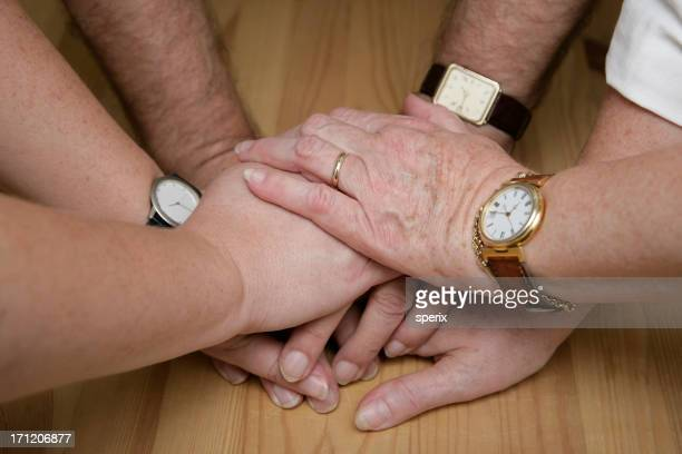 Hands liked on top of each other showing there together
