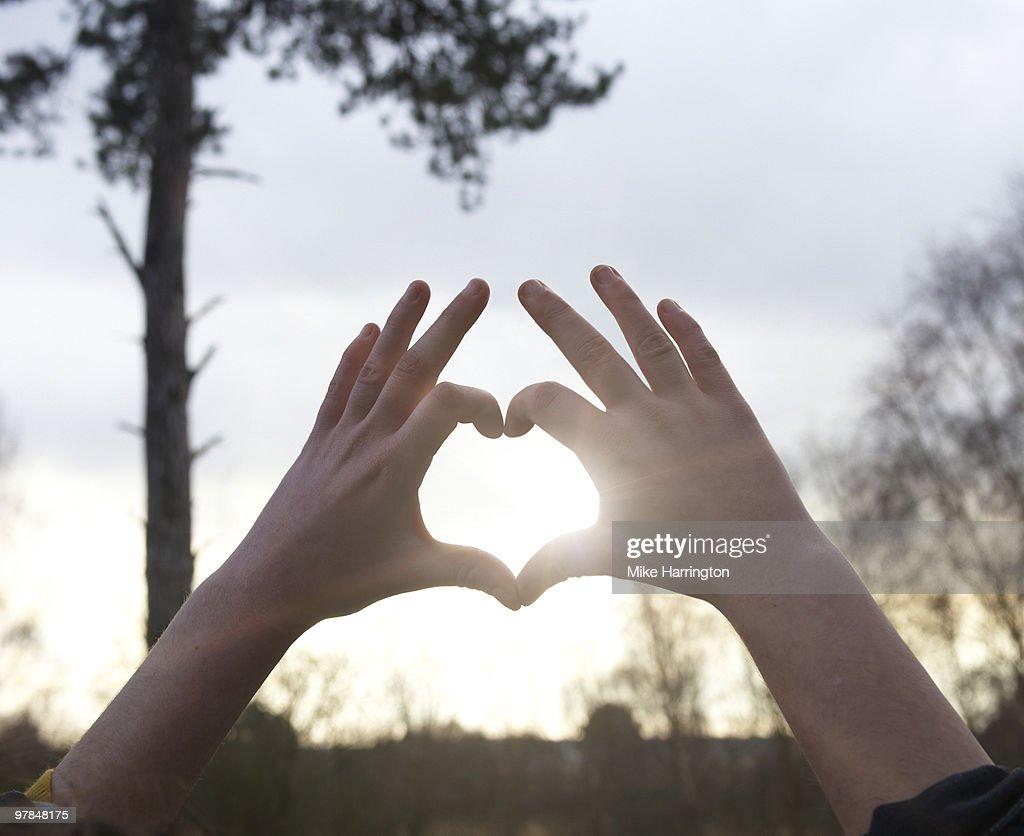 Hands making a heart shape : Stock Photo