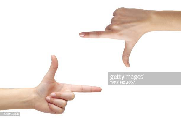 hands making frame - pointing at camera stock photos and pictures