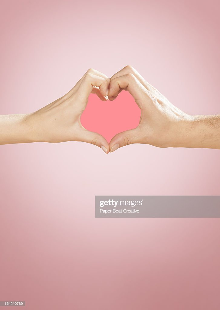 Hands making heart shape in studio : Stock Photo