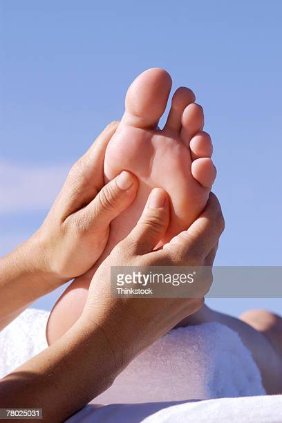 Hands massaging foot