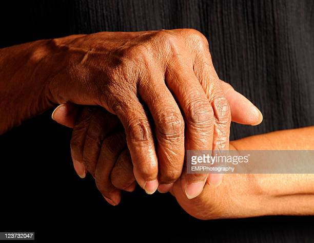 Hands of a  An African America Senior Isolated on Black