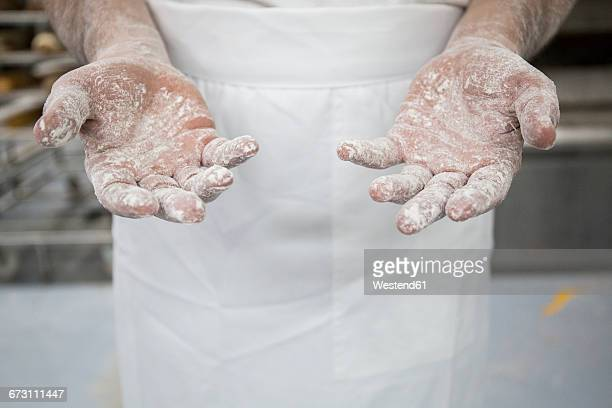 Hands of a baker with flour
