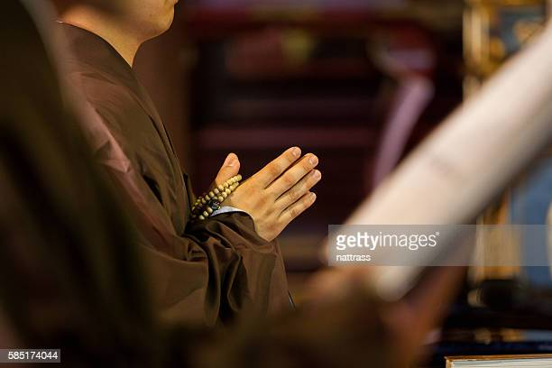 hands of a buddhist monk praying - buddhism stock pictures, royalty-free photos & images